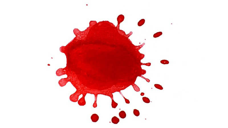 Roter Farbklecks auf weißem Hintergrund