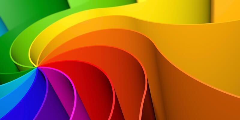 Abstrakte geometrische Figur in wellenartigen Regenbogenfarben