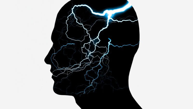 Grafik menschlicher schwarzer Kopf mit Blitzen