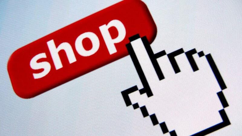 Mauszeiger in Form von Hand zeigt auf rotes Schild mit Aufschrift Shop
