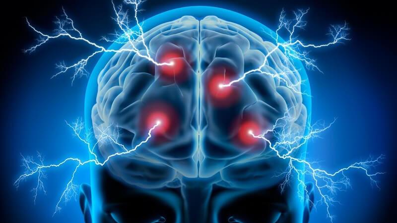 Blaue 3-D-Grafik eines Kopfes mit sichtbarem Gehirn und roten Punkten mit Blitzen (Geistesblitze)