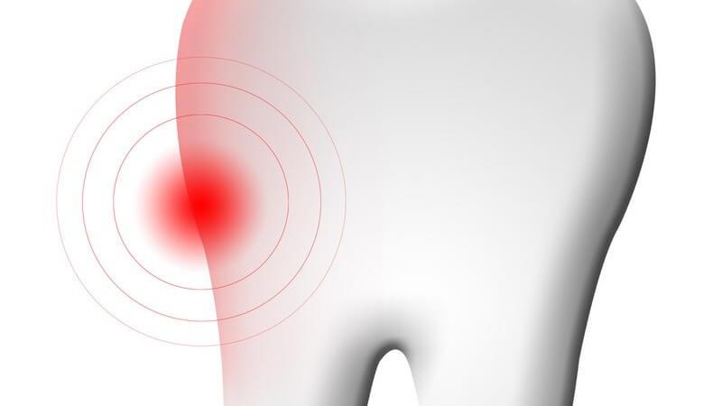 Grafik Zahn, Zahnschmerzen durch roten Punkt markiert