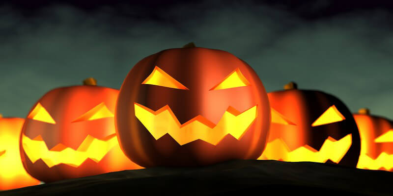 Grafik Reihe von Halloween Kürbissen mit leuchtenden Gesichtern